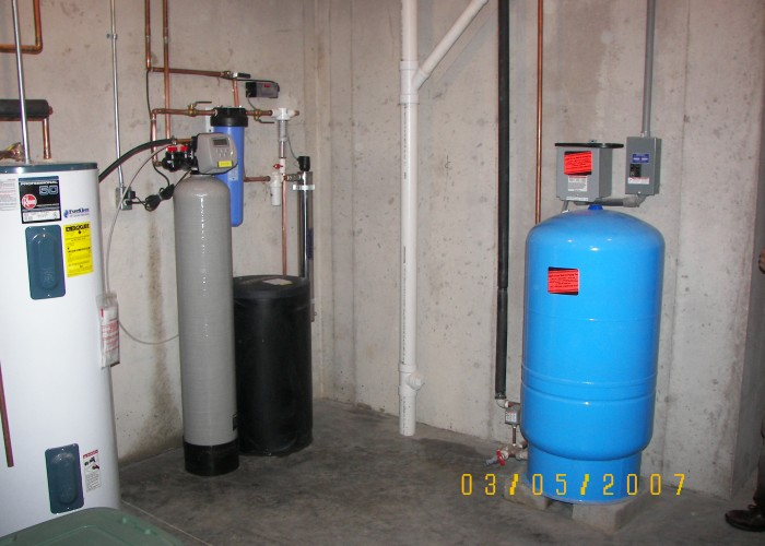 Left to right - softener, carbon taste & odor filter, sediment filter, ultra-violet disinfection light for bacteria, well tank & pump controls FILTER, ULTRA-VIOLET  DISINFECTION LIGHT FOR BACTERIA, WELL TANK & PUMP CONTROLS